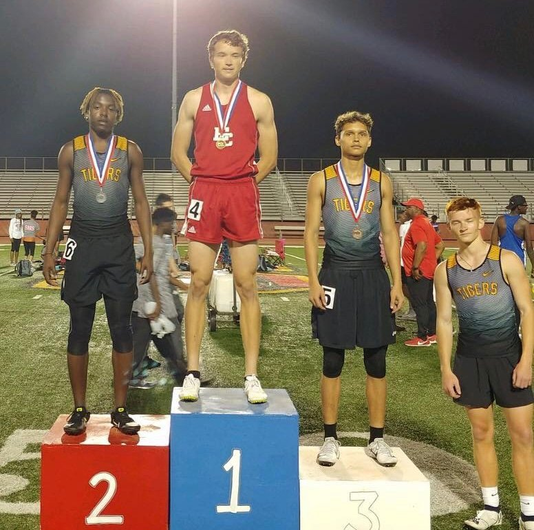 Sometimes a picture is worth a thousand words. This one is worth 22 points which came thanks to consecutive finishes in the 300-meter hurdle race. Draper Parker (left) came in second and was followed closely by Emmanuel Aguilar (3) and James Gassiott (right) in collecting points in the longer of the two hurdle races.