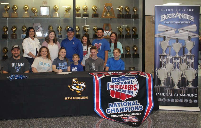 Soon-to-be Sealy graduate Laci Prause was joined by friends, family, and coaches in celebrating her signing her National Letter of Intent to cheer at Blinn College.