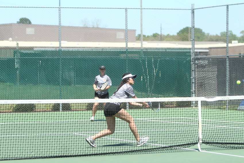 Tina Pham (foreground) and Rachel Faldyn were the first girl double representatives from Sealy at the Region IV Championships since 1998.