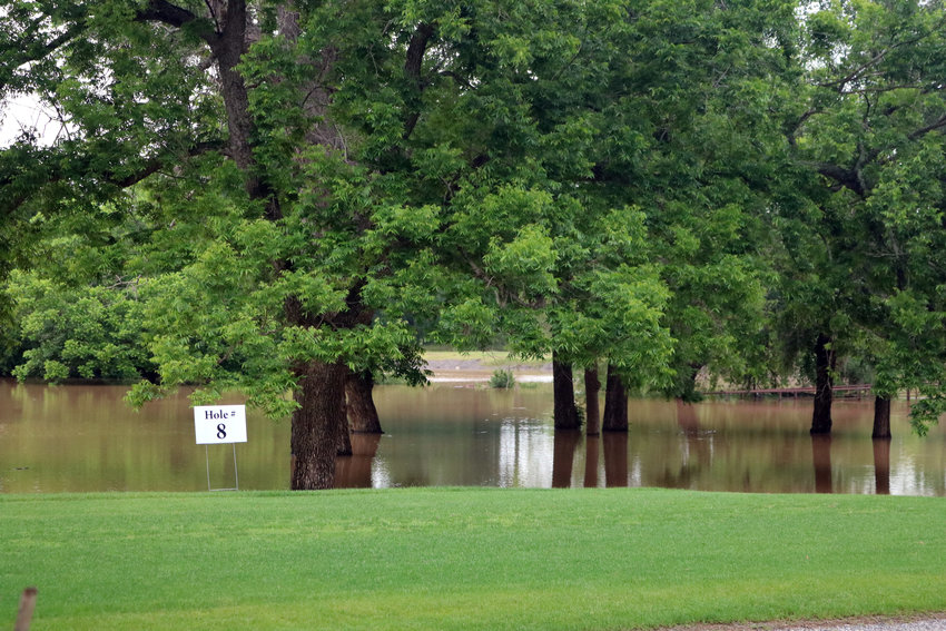 The eighth hole of the Stephen F. Austin Golf Course was under water Wednesday afternoon.