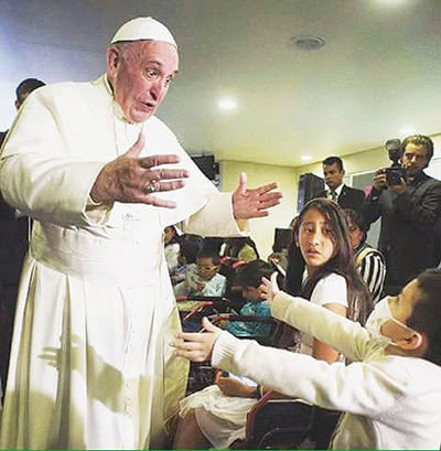 Pope Francis blesses Ricky Padilla, then 5, of Sealy, while in Mexico City among a crowd of thousands. The Padilla family visited Mexico City for Ricky to receive cancer treatment at Hospital Infantil de México Federico Gómez.
