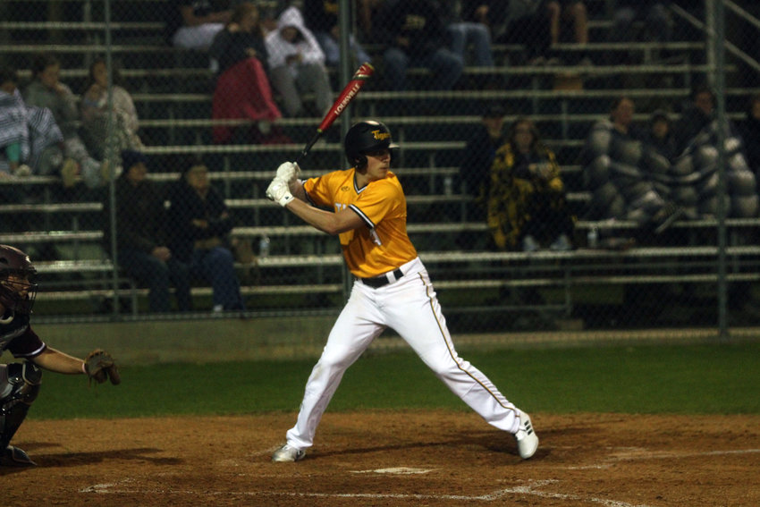 Garret Zaskoda sent the Tigers pouring out of the dugout with his winning hit in extra innings of the Bi-District championship against La Grange. Here, Zaskoda readies his swing in the season opener against Columbia.