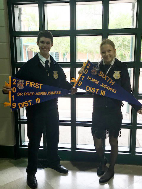 Sophomore classmates Tanner David (left) and Tyler Johnston (right) display banners for their achievements during the FFA year. David placed first in prepared public speaking in agribusiness and Johnston was a member of the horse judging team that finished sixth overall.
