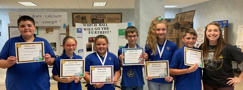 Faith Academy students worked hard to create their science experiments and were rewarded for their efforts. From left are Seth Blaschke, Avery Swierkowski, Darcy Luedke, Colton Randall, Olivia Bagnall and Joe Bob Lequerica.
