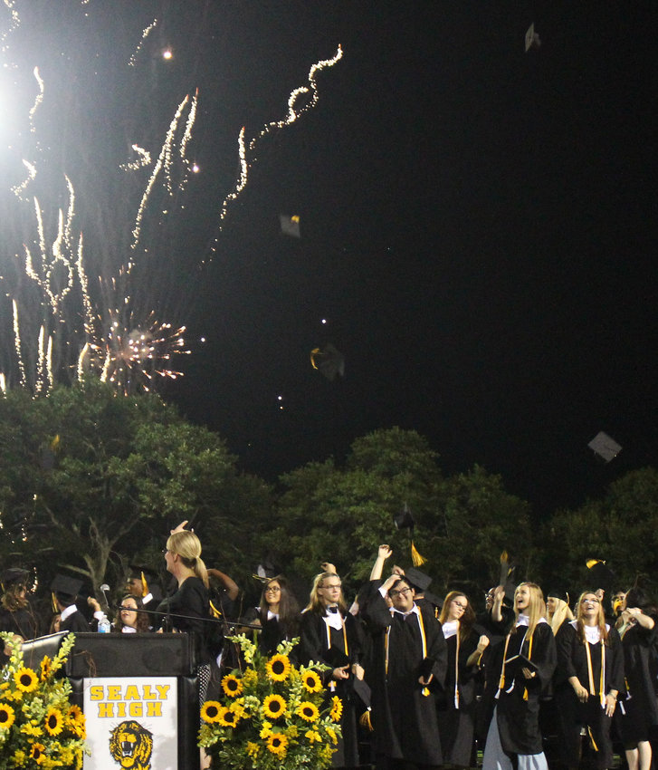 Sealy High Schools' 2019 graduation ended with graduation caps entering the sky before a backdrop of fireworks that colorfully lit up the sky and put a memorable end on a night students and families will long remember.