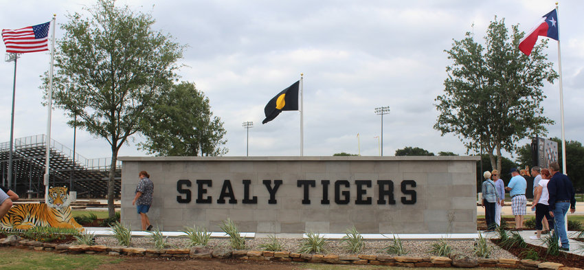 The Gold Dot flag flies in between our nation's and state's colors at the Tiger Wall of Honor in between the football and baseball stadiums on Highway 90.