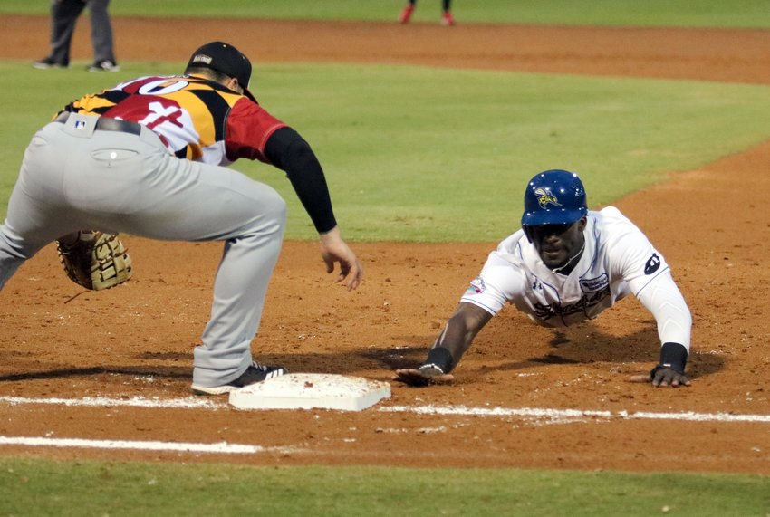 Jared Mitchell slides safe back to first during Tuesday's game at Constellation Field. The Sugar Land Skeeters beat the Southern Maryland Blue Crabs 4-1.