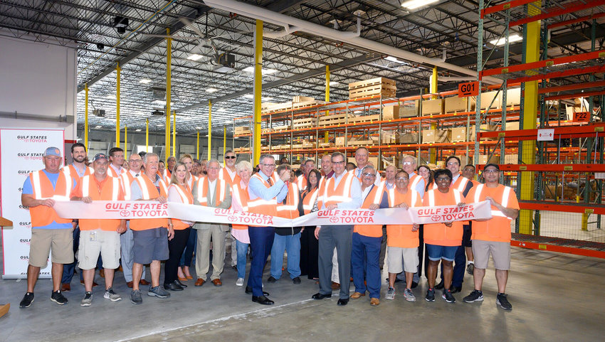 Pictured cutting the ribbon for the new expansion of Gulf States Toyota's Parts Distribution Center in Sealy are Jeff Parent, president and general manager, Gulf States Toyota, and Manuel Sanchez, director, Parts Distribution Center, Gulf States Toyota.