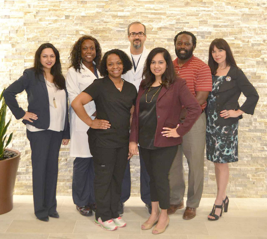 Houston Methodist Sugar Land Hospital's bariatric surgical center has been accredited as a Low Acuity Center under the Metabolic and Bariatric Surgery Accreditation and Quality Improvement Program by the American College of Surgeons and the American Society for Metabolic and Bariatric Surgery. Pictured from the left are (top row) Rashna Barge, Diane Ofili, PA-C, Nabil Tariq, MD, Damon Smith, RN, MBSCR and Gabrielle Rodriguez, MA, LPC. In the bottom row (from left) are Erica Bess, PCA, and Jayne Thomas, RDN, LD, CDE.