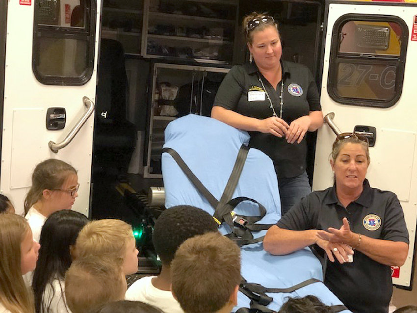 Candi Havemann and Tammy Wendel of the Austin County EMS give a safety presentation to children as part of Youth and Safety Day.