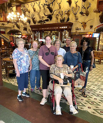 Pictured from the left are (back row) Delores Kuenhn, Jessie Kokemor, Kate Buenger, Doris Glenewinkel, Joan Buenger, Judy Schulz and Michelle Wright, and (seated) Knellen Quinteros at their educational tour of San Antonio.