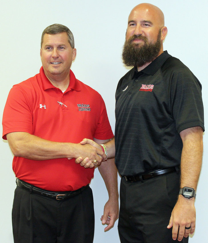 Ryan Roecker comes from Anahuac most recently. You can read more about his story in the sports section. Joining Roecker in confirming the hire is Brazos Superintendent Brian Thompson (left).