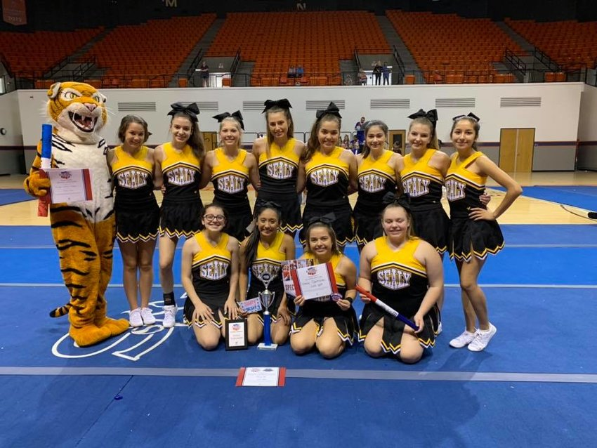 "As a team, they received the Herkie Spirit Award for ""exemplifying what it means to be a cheerleader, voted on by the whole camp,"" according to head coach Ariel Bennett. In addition, Emily Contreras was honored as All-American and Morgan Smith, taking over Tiggy duties this year, was voted the best all-around mascot, the leadership awarded and garnered All-American Mascot distinction."