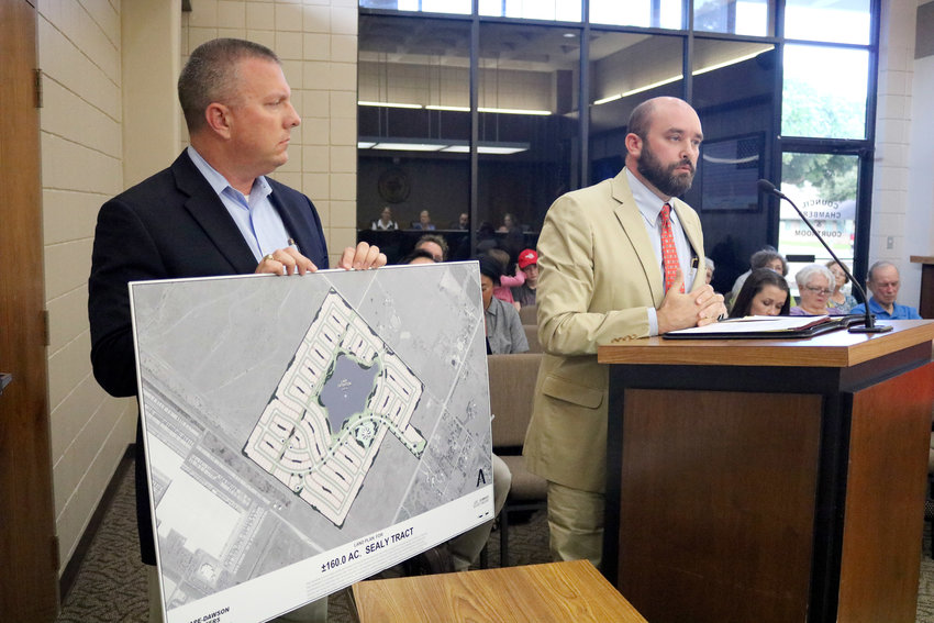 Michael Preiss with Pape-Dawson Engineers, left, and attorney Ryan LaRue give a presentation about the proposed LGI Homes subdivision to the Sealy City Council at last Tuesday's meeting. The developer wants the city to create a Public Improvement District to help construct the 440-lot subdivision.