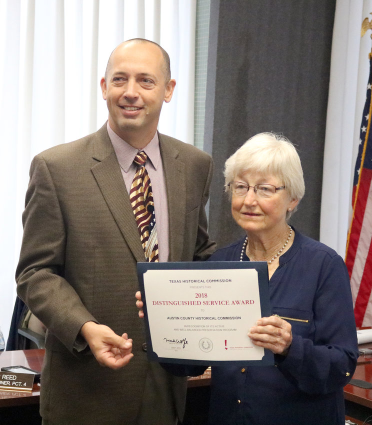 Austin County Judge Tim Lapham presents Grace Holtcamp of the Austin County Historical Commission with the 2018 Distinguished Service Award by the Texas Historical Commission.