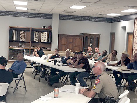 Local law enforcement officers participate in Operation Safe Kids, held June 20 at the Bellville Fire Station.