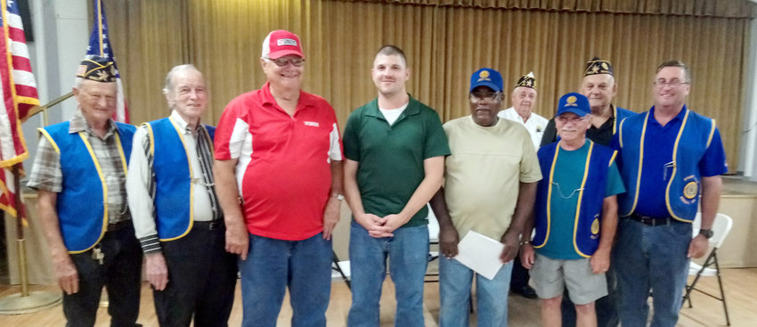 The 2019-2020 American Legion officers are, from the left, Charles Toman (Sgt-at-Arms), Charlie Burchfield (Executive Committee), Pete Berckenhoff (Executive Committee), Matthew Howard (Judge Avocate), Lawrence Page (Chaplain), Ronnie Smith (Finance Officer), Paul Dronka (Commander), and David Littmann (Adjutant).