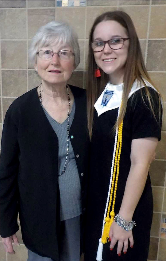 Hope Raesner was present at the chapter meeting in May and read her essay. She plans to major in nursing as her chosen career. Pictured with Hope is GraceHoltkamp.