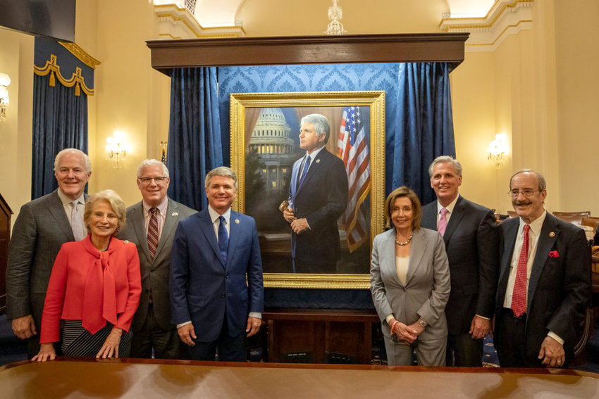 Rep. Michael McCaul and other members of Congress and the Senate pose before his official portrait, which was unveiled last week and will adorn the halls of the Capitol.
