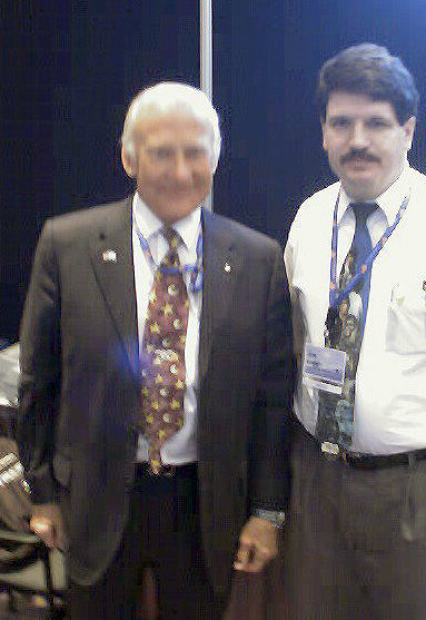 This fuzzy photo shows Joe Southern with Buzz Aldrin, the second man to walk on the moon, during an interview at the National Space Symposium in Colorado Springs, Colo., in 2004.