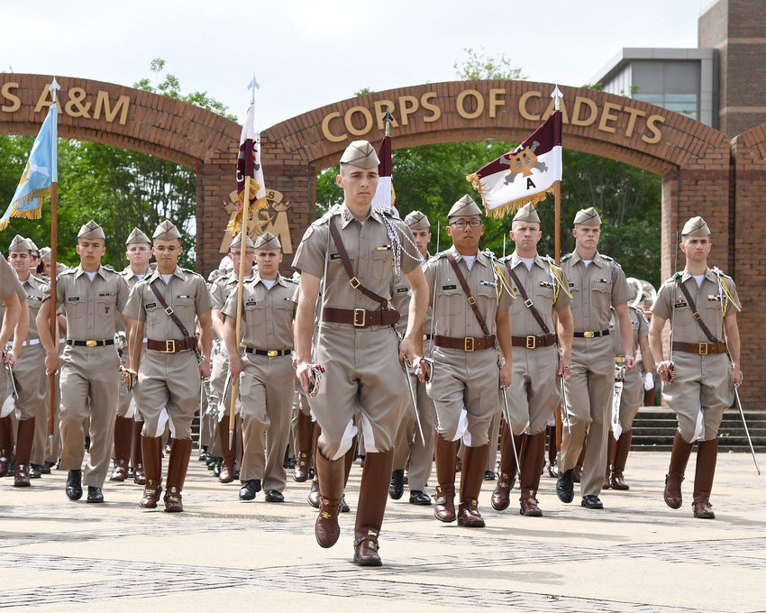 Nick Rossi (foreground), leads the Corps of Cadets to a military review where their marching and presence is shown off for parents and visiting military officers.