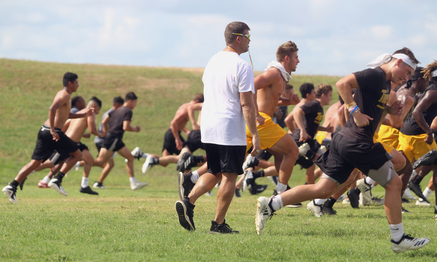 The Tigers were out in full force on the football practice fields Monday morning for the beginning of camp and closed out day one's first session with 16 100-yard sprints performed as a team under the watchful eyes of head coach Shane Mobley (sunglasses).