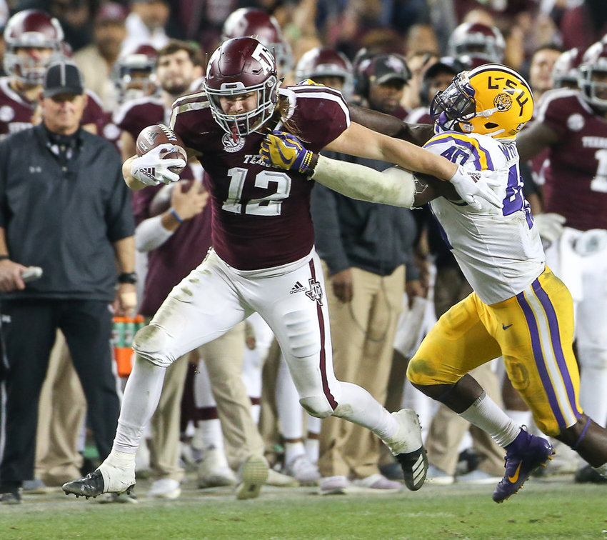 Photo by Scott W. Coleman    Texas A&M Aggies fullback Cullen Gillaspia (12) tries to escape the grasp of LSU Tigers linebacker Devin White (40) after catching a pass during an NCAA college football game between Texas A&M and LSU at Kyle Field on Saturday, Nov. 24, 2018 in College Station, TX. Gillaspia, a Taylor High School product, was drafted in the seventh round of the 2019 NFL Draft by the Texans.