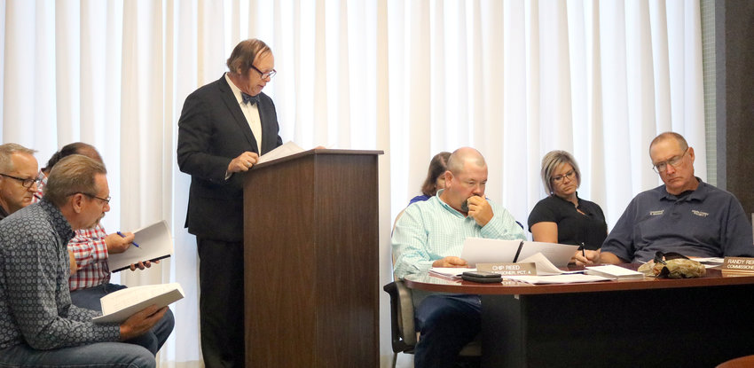 Auditor Wayne Beyer of Beyer Company goes over Austin County's audit during the Aug. 5 commissioners court meeting. He gave the county a clean report.