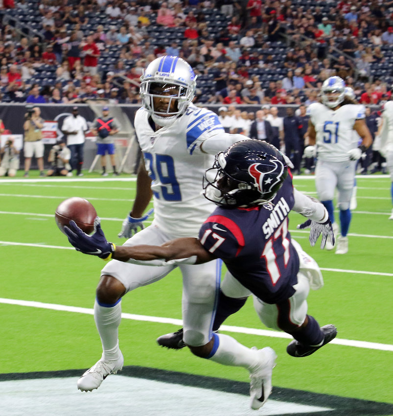 Vyncint Smith nearly one-hands a touchdown catch as Rashaan Melvin defends for Detroit during Saturday's pre-season game at NRG Stadium. The Houston Texans defeated the Lions 30-23.