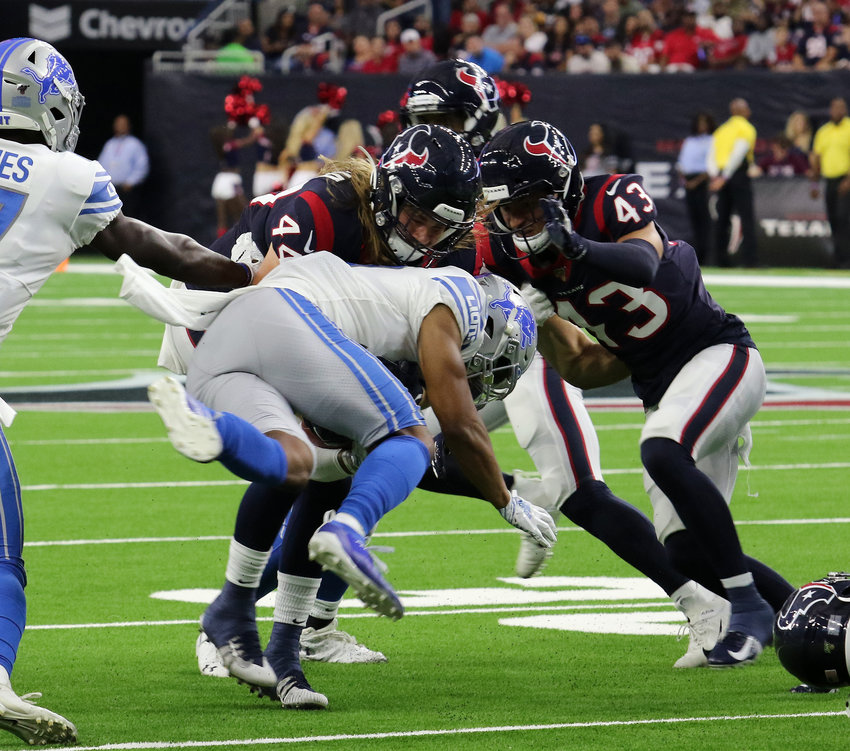 Detroit corner back Jamal Agnew is tackled by Texans Cullen Gillaspia (44) and Chris Johnson (43) during Saturday's pre-season game at NRG Stadium. The Houston Texans defeated the Detroit Lions 30-23.