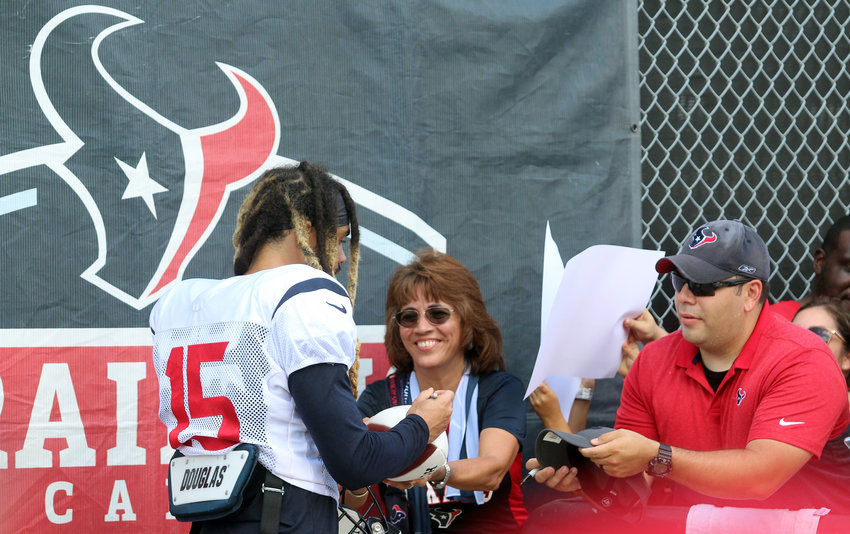Will Fuller (15) was one of the first Texans emerging from the practice field, eliciting wild reactions. He clearly made at least one fan happy with his signature after last Wednesday's practice.