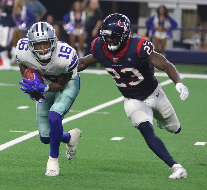 Dallas Cowboys receiver Cedrick Wilson is chased down by Houston Texans cornerback Johnson Bademosi during Saturday's pre-season game in Dallas. The Cowboys crushed the Texans 34-0.
