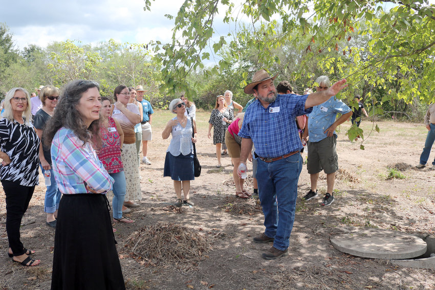 Michael Moore shows volunteers places where proposed replica buildings will be built as part of an expansion at the San Felipe de Austin State Historic Site and Museum.