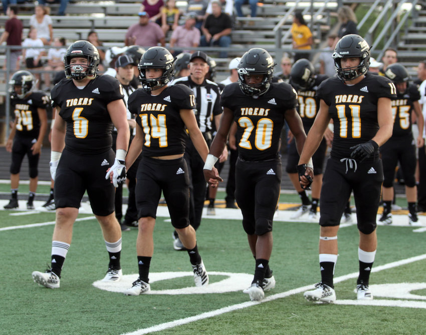 Garrett Redden (6), Carter Cryan (14), Matthew Lord (20) and Hunter Clark (11) served as the Sealy Tiger captains for the season-opening game with the Wharton Tigers Friday night at T.J. Mills Stadium.