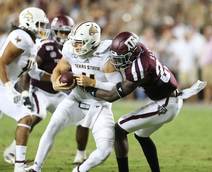 Texas A&M Aggies defensive back Roney Elam (27) sacks Texas State Bobcats quarterback Tyler Vitt (11) during an NCAA football game between Texas A&M and Texas State at Kyle Field in College Station, Texas on August 29, 2019.