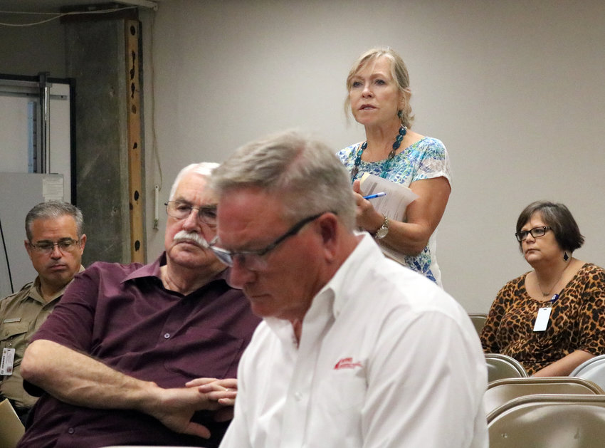 Linda Niehuus speaks out during a public hearing in opposition to the proposed 2-cent property tax increase at Monday's meeting of the Austin County Commissioners Court.
