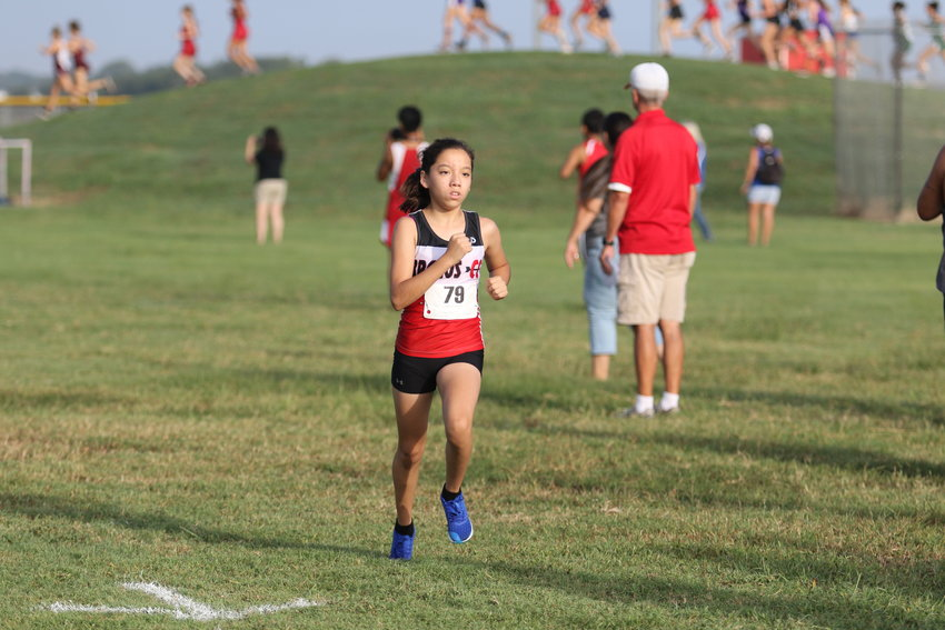 Rubi Garcia came across the finish line first in the girls' varsity race at Brazos' host meet for her second win of just her freshman campaign. Her twin sister, Esmeralda, finished runner-up last week to help the Cougarettes win the meet hosted at Brazos High School for the 13th year in a row.