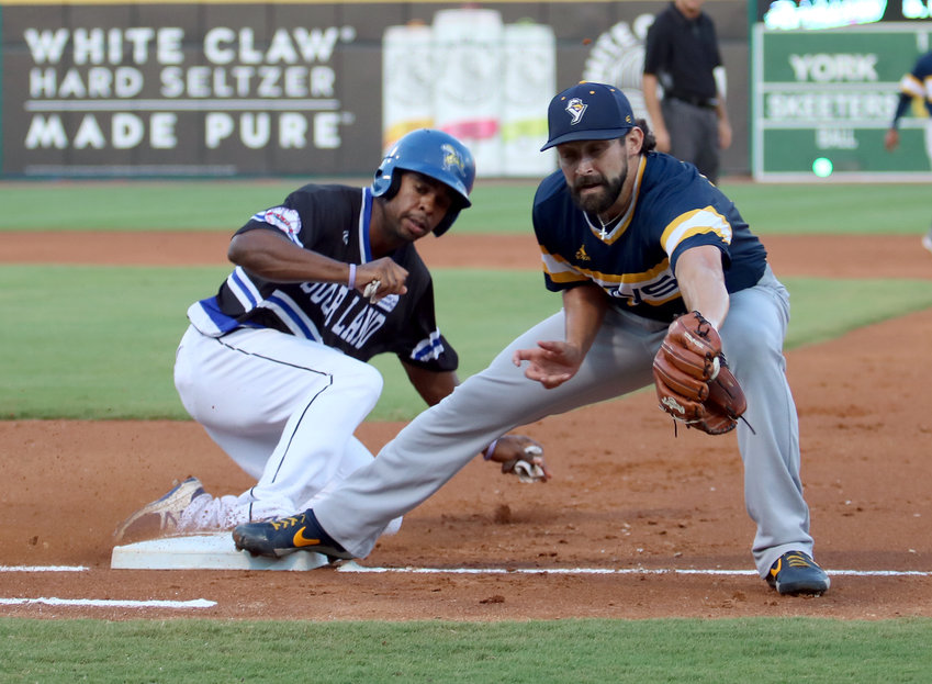 Wynton Bernard beats a throw back to first base as York's Telvin Nash makes the catch during the Sugar Land Skeeters 10-8 loss to the Revolution on Sept. 5 at Constellation Field.