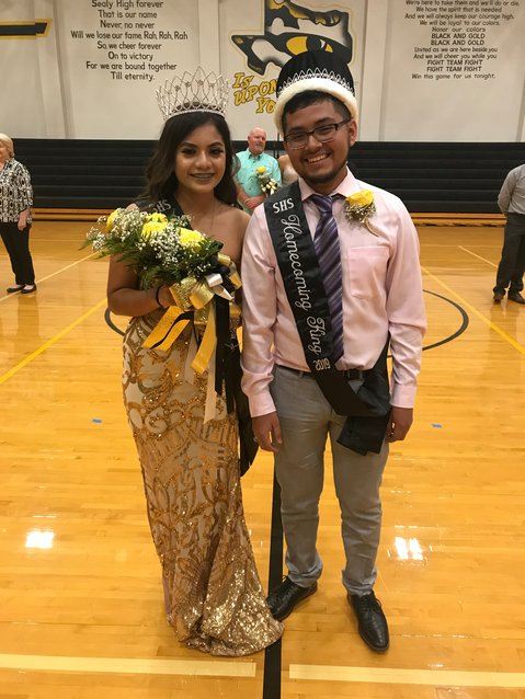 Christina Gomez and Axel Pavon were crowned as 2019 homecoming king and queen Saturday night after the announcement was postponed due to the cancellation of the rest of Friday night's football game. No amount of rain could wash away these smiles, however.