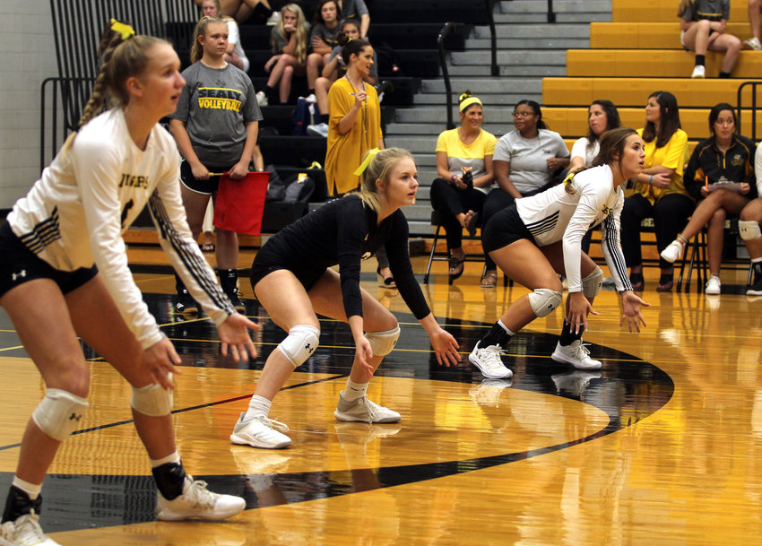 The Sealy trio of Breanna Brandes (left), Alyssa Foertsch (center) and Raegan Newsome were big contributors in the district-opening win over Wharton. Brandes registered team-second bests in kills (6), blocks (2) and assists (13) and added a pair of service aces. Foertsch led the team in the digs (9) and aces (6) categories while Newsome compiled the most kills (7) and added six digs.