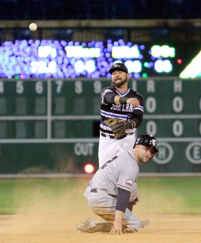 Sugar Land Skeeters second baseman Javier Betancourt makes a throw to first in an attempt to make a double-play Saturday against the Southern Maryland Blue Crabs. The Skeeters won 3-2.