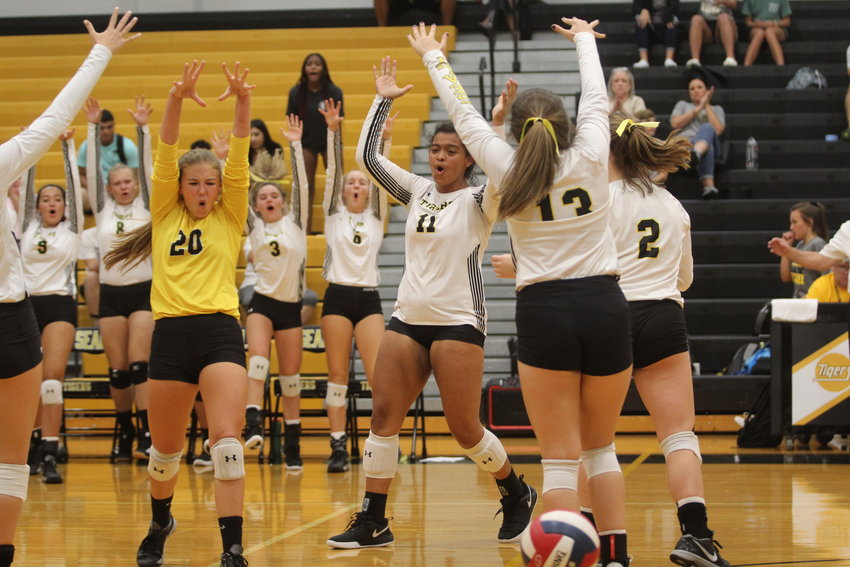 The Lady Tigers had plenty of celebrating to do earlier last week after picking up their second district win in as many chances, this one over Stafford, 3-0. Pictured is Brooke Kram (20), Haley Reese (11) and teammates celebrating a block against the Caldwell Lady Hornets.