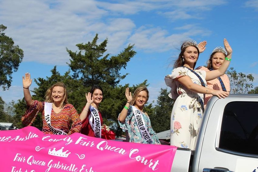 Members of the Austin County Fair Queen's Court wave as they go by in last year's parade. This year's parade will be held Thursday in Bellville.