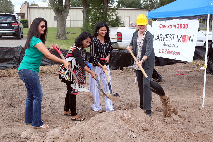 Harvest Moon Apartments broke ground Friday off Highway 90 in Sealy. Pictured are investors Ana Katamreddy, Mamta Yerneni and Sailaja Patibandla, along with Sealy Mayor Janice Whitehead.