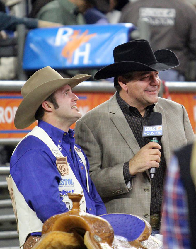 Boyd Polhamus, right, visits with a winner at last spring's RodeoHouston. The famed rodeo announcer will be doing his thing at the Austin County Fair rodeo Oct. 10-12.