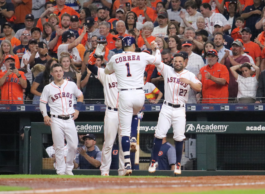 Carlos Correa and Jose Altuve celebrate a run during a game earlier this season. The Houston Astros have the best record in baseball this year at 107-55 and hold homefield advantage throughout the playoffs, which begin Friday in Houston.