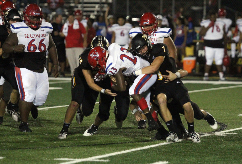 The Tiger defense held Brazosport off the scoreboard for two quarters but a 15-point fourth quarter helped the Exporters emerge with a 21-20 win in Sealy Friday night.