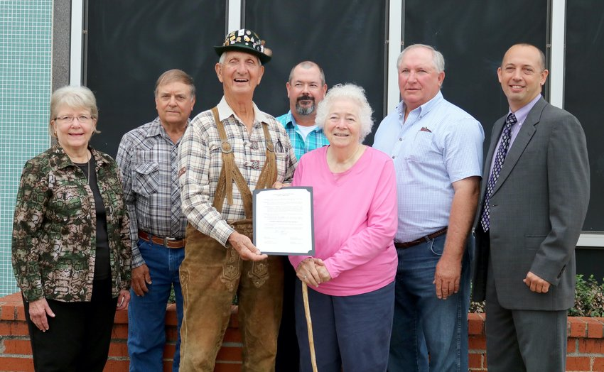 Members of the Bluebonnet Chapter of Texas German Society pose with Austin County Judge Tim Lapham and members of the Austin County Commissioners Court Monday for a presentation of the proclamation declaring October as German American Month in Austin County.