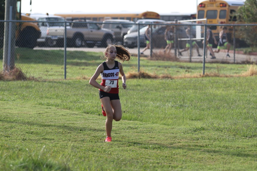 Gracie Arteaga earned her first win of the season at the District 29-2A Championship Monday morning in Shiner and it helped her team take the top spot for the 17th year in a row and advance to the Region IV Championship Oct. 28 in Corpus Christi.