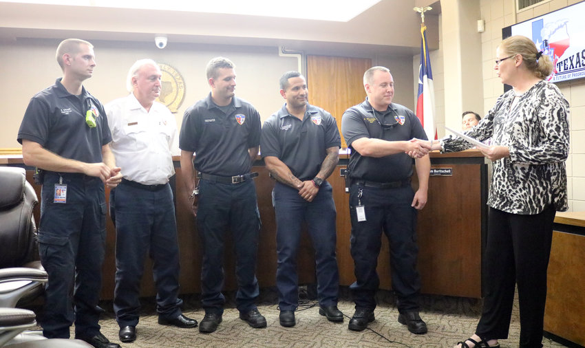 Mayor Janice Whitehead, right, presents a proclamation declaring Oct. 6-12 as National Fire Prevention Week to firefighters Kevin Kramr, Joey Schmidt, Dillon Marburger, Jesus Almaguer Jr. and Adam Williamson during the Oct. 15 meeting of the Sealy City Council.
